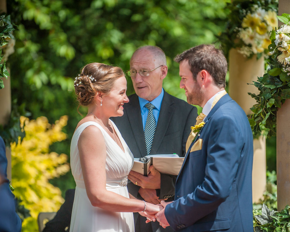 Bride and groom exchanging vows, outdoor ceremony, Ringwood Hall weddings, Sheffield wedding photographer