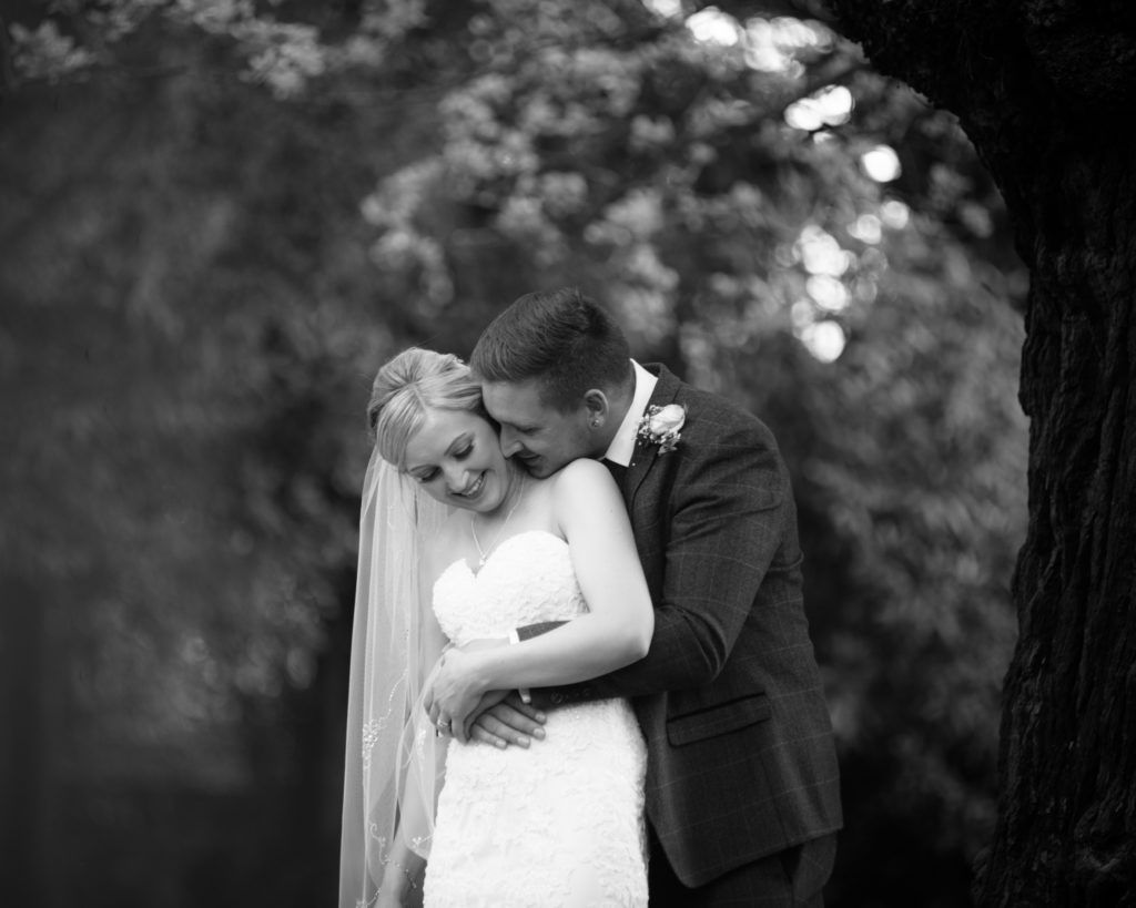 Groom kissing bride's neck, Wortley Hall, Sheffield wedding photography