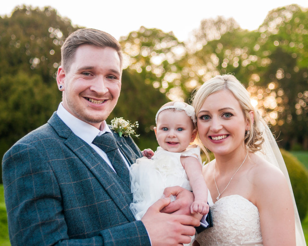 Bride and groom with daughter posing, Wortley Hall, Sheffield wedding photography