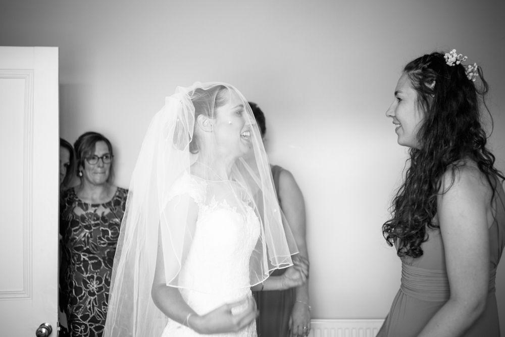 Bride putting on dress and bridesmaids reaction, documentary wedding portraits Sheffield, Sheffield-Wedding-Handsworth