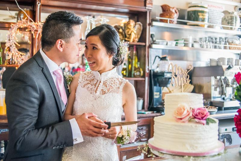 Cutting the cake wedding day in Sheffield