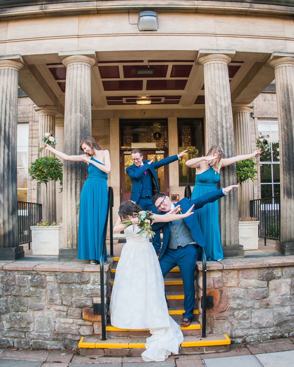 Bridal party dabbing at Halifax Hall in Sheffield