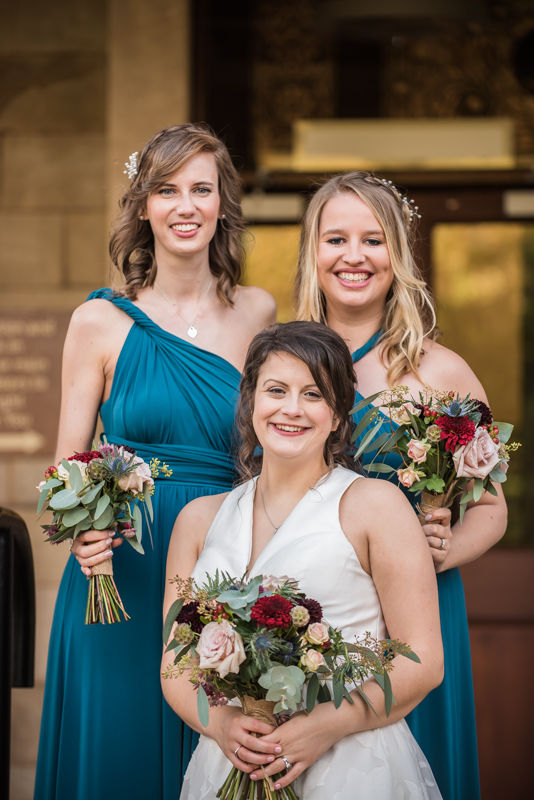 Bride and bridesmaids smiles outside Halifax Hall in Sheffield