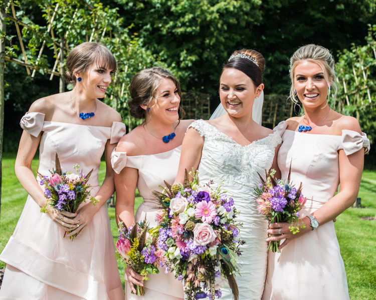 Bridesmaids laughing at Hazel Gap Barn wedding