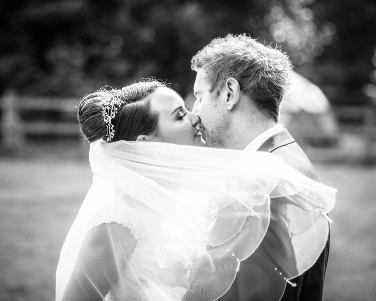 Kisses for bride and groom Joelle & Scott in Sheffield