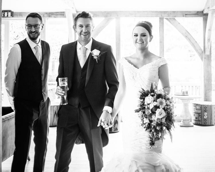 Entering the reception at Hazel Gap Barn at a summer wedding