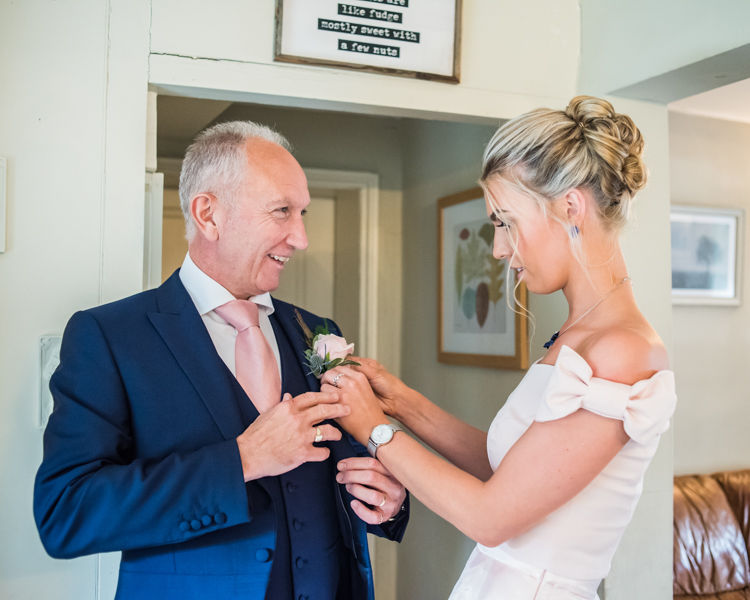 Joelle's Dad getting his buttonhole on for the wedding day