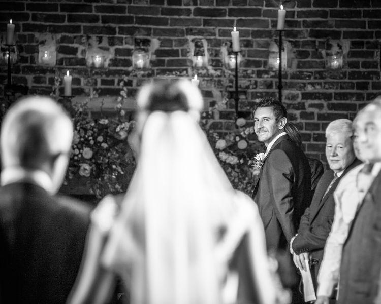 Scott looking back at Joelle at their Sheffield wedding at Hazel Gap Barn