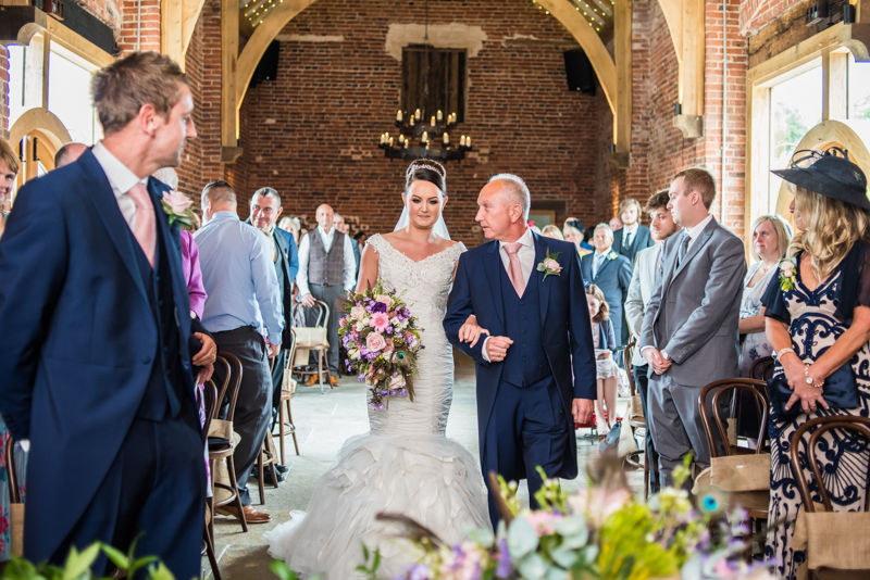 Joelle reaches the top of the aisle at their Sheffield wedding at Hazel Gap Barn