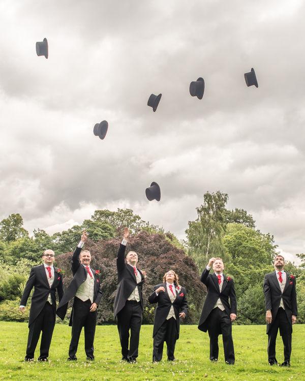 Groomsmen hat toss wedding photos at Kenwood Hall