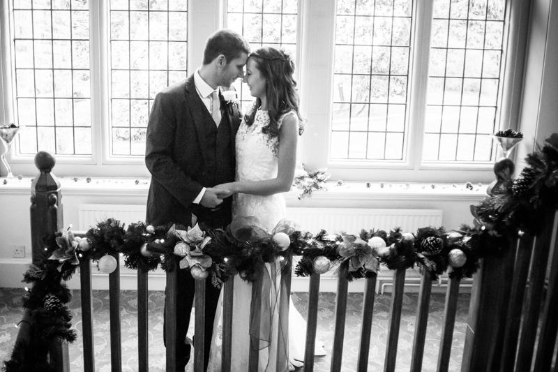 Kisses on staircase Sheffield wedding photographers Whirlowbrook Hall