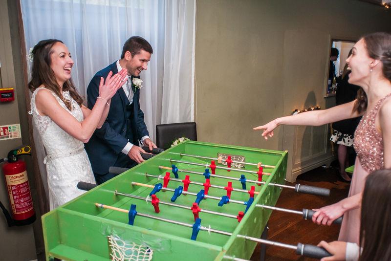Wedding table football Sheffield wedding photographers Whirlowbrook Hall