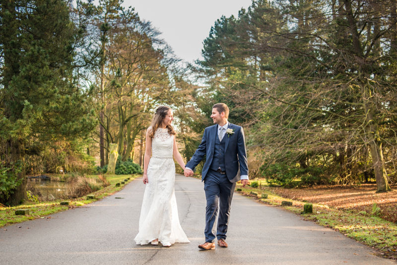 Walking in grounds Sheffield wedding photographers Whirlowbrook Hall