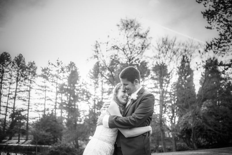 Cuddles for bride and groom Sheffield wedding photographers Whirlowbrook Hall