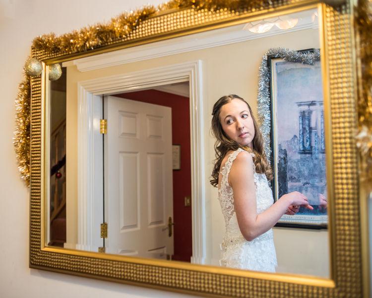 Nikki looking in mirror - Sheffield wedding photographers