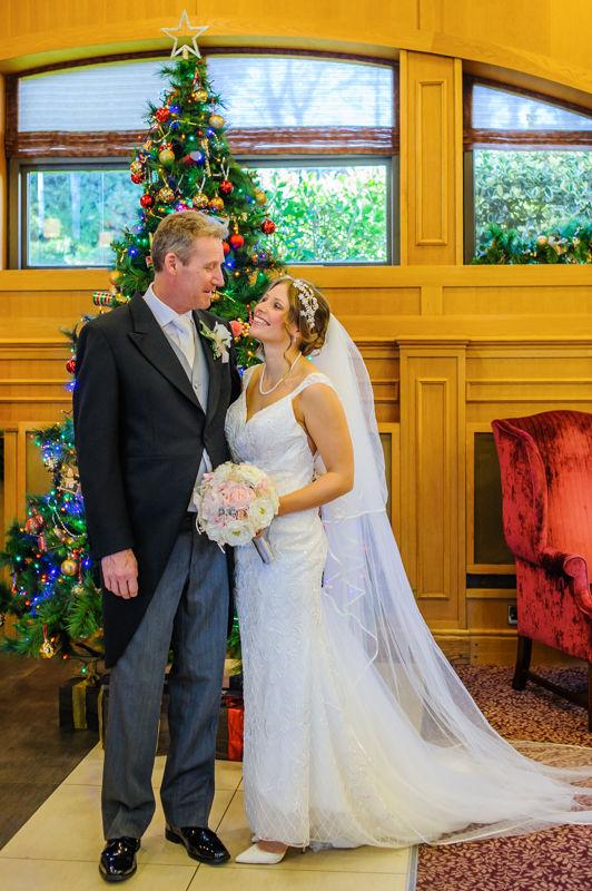 Amanda and her Dad by Christmas tree Hellaby Hall wedding photographers Rotherham