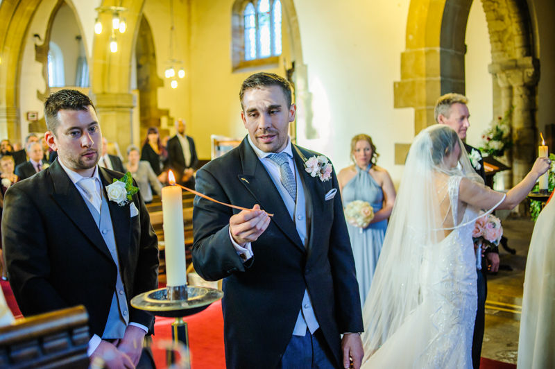 Lighting candles wedding in Whiston