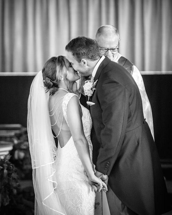 First kiss - wedding at Whiston Church