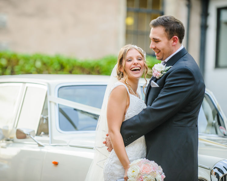 Amanda and Tim with their wedding car,Hellaby Hall wedding photographers Rotherham