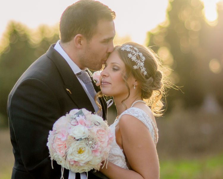 Bride and groom kisses at sunset Hellaby Hall wedding photographers Rotherham