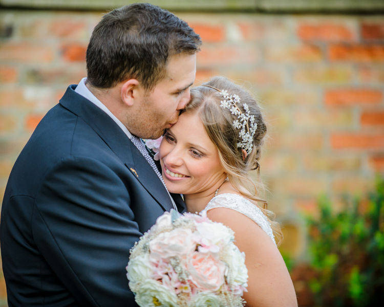 Bride and groom cuddles Hellaby Hall wedding photographers Rotherham