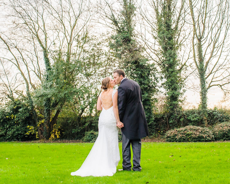 Kisses for bride and groom, Hellaby Hall wedding photographers Rotherham