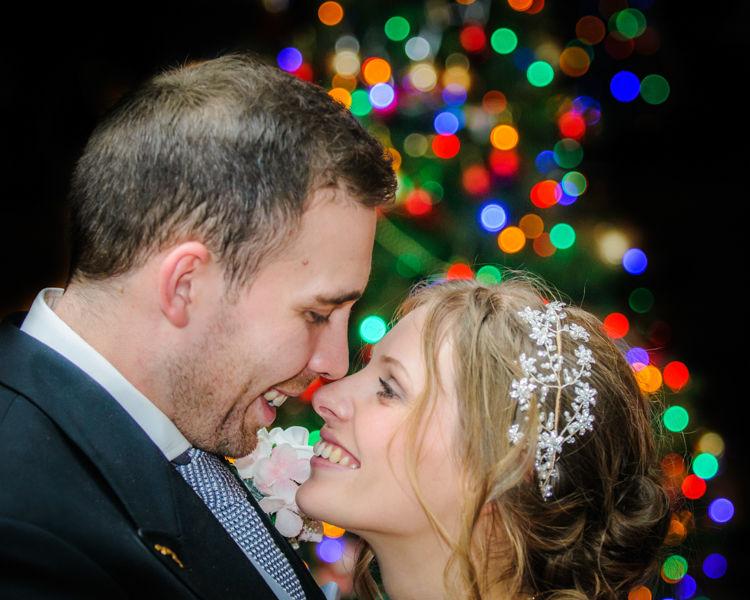Bride and groom by Christmas tree, Hellaby Hall wedding photographers Rotherham