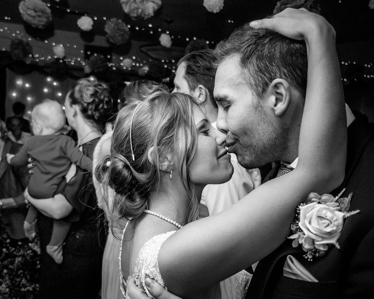 Bride and groom kiss on dancefloor, Hellaby Hall wedding photographers Rotherham