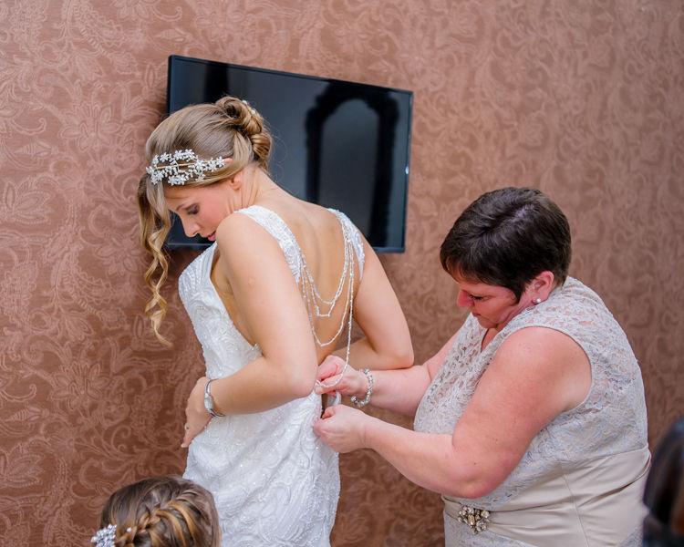 Amanda getting wedding dress on Hellaby Hall wedding photographers Rotherham