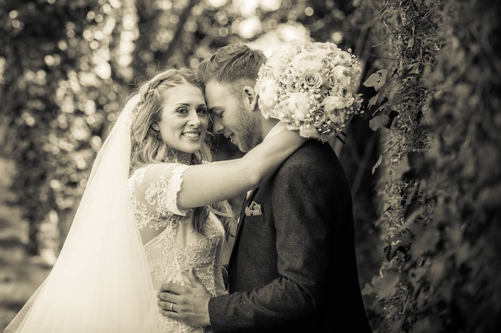 Bride and groom touching heads, Cockermouth wedding photographers
