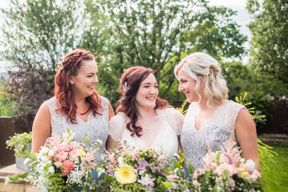 Bride and bridesmaids laughing, Cumbria wedding photographers
