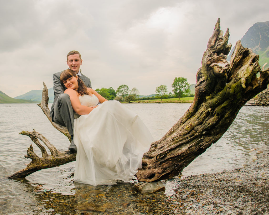 Bride and groom on branch in Crummock, Lake District weddings