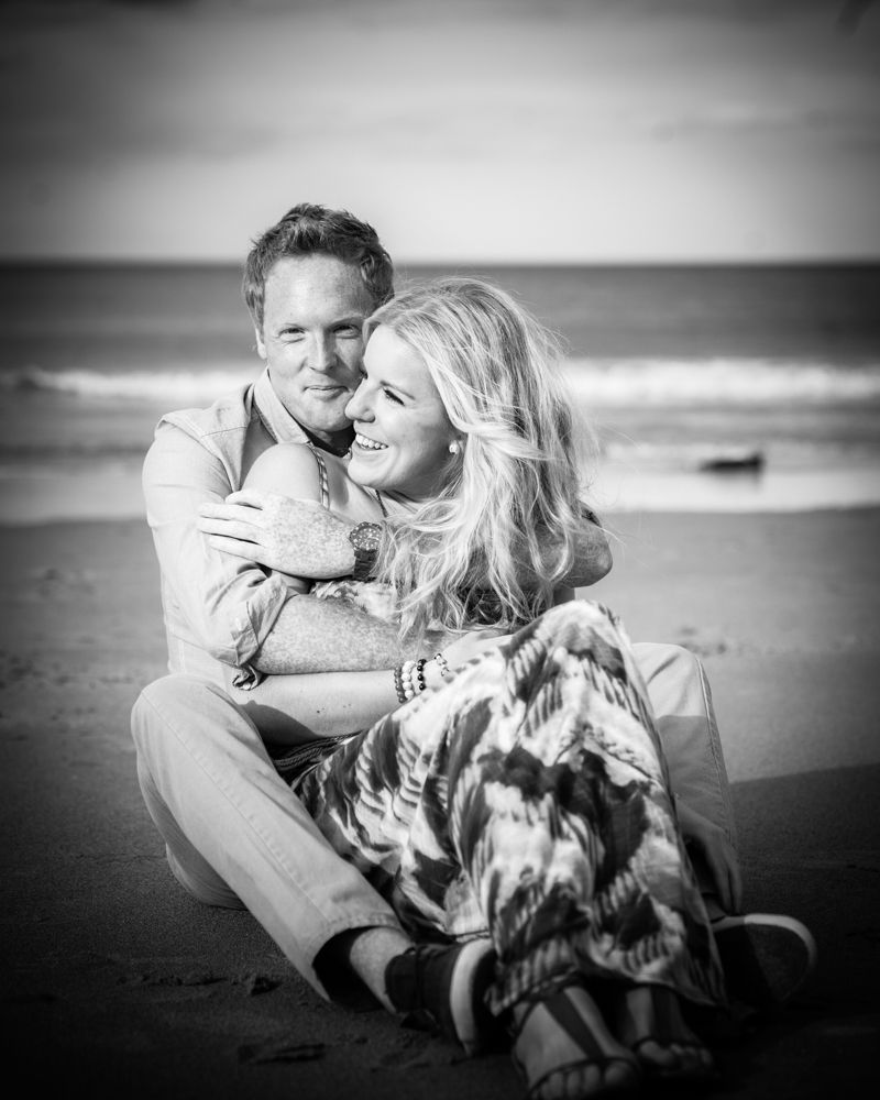 Cuddles on beach, wedding photographer Cumbria