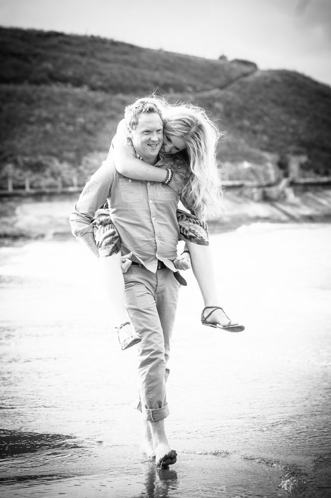 Piggy back on beach, engagement photos Tynemouth