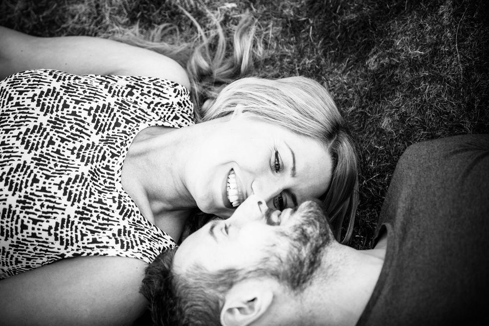 Pre-wedding portraits, Curbar Edge lying in grass