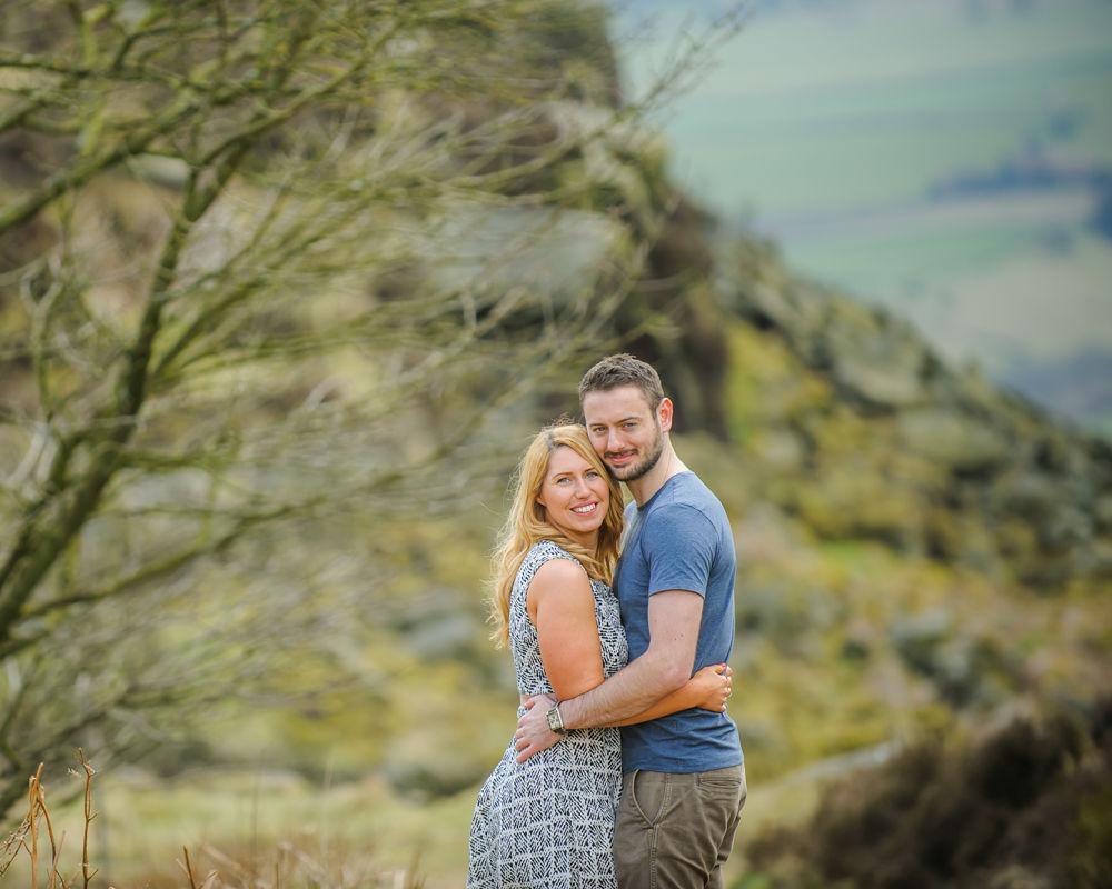 Cuddles on pre-wedding portraits, Curbar Edge