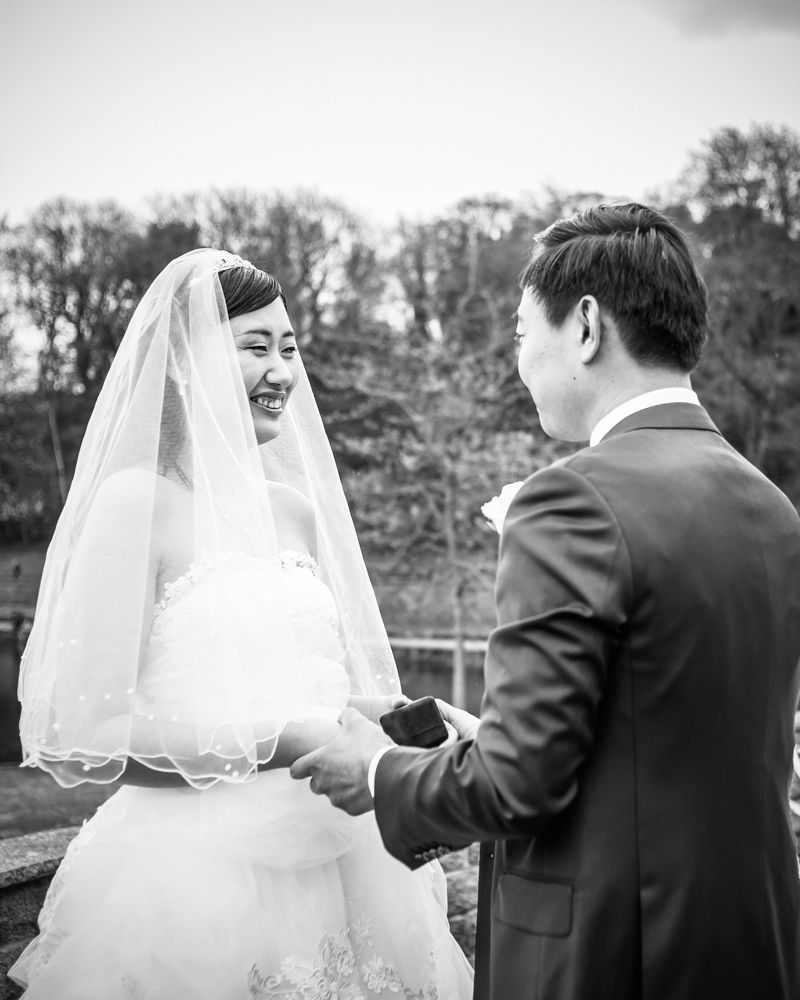 Bride and groom exchanging rings, Sheffield wedding photographer, Chinese wedding