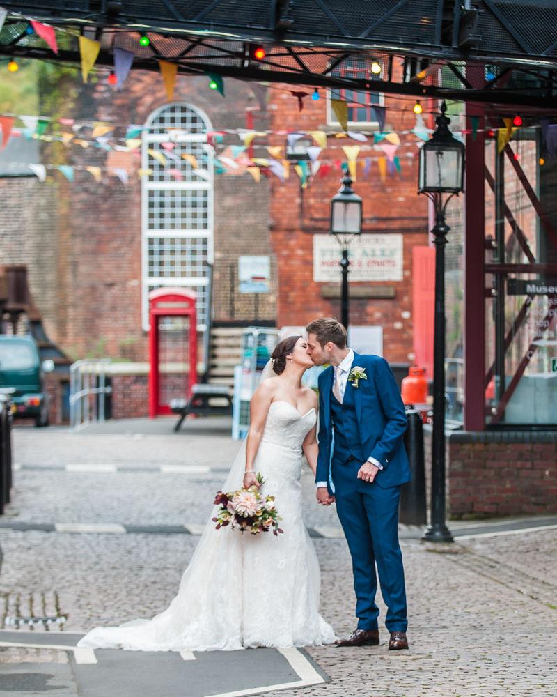 Kisses under bunting, Kelham Island wedding, Sheffield photographers
