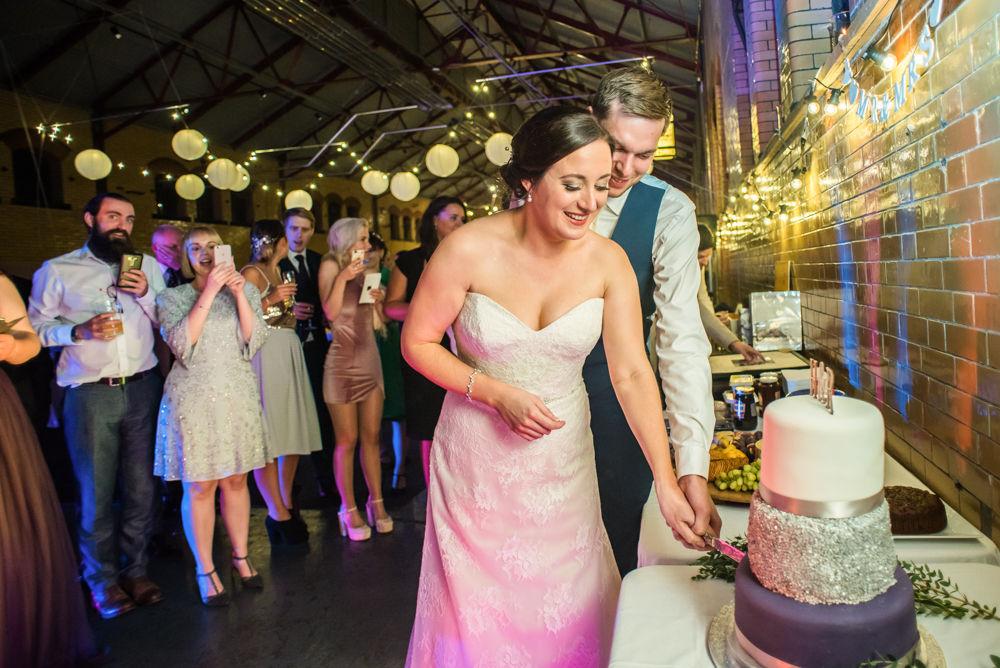 Cutting cake, Kelham Island wedding, Sheffield photographers