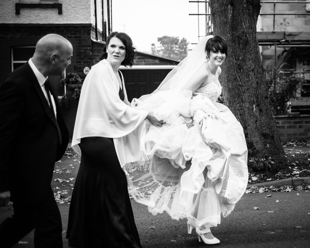 Bride walking to church, Maynard wedding, Sheffield photographers