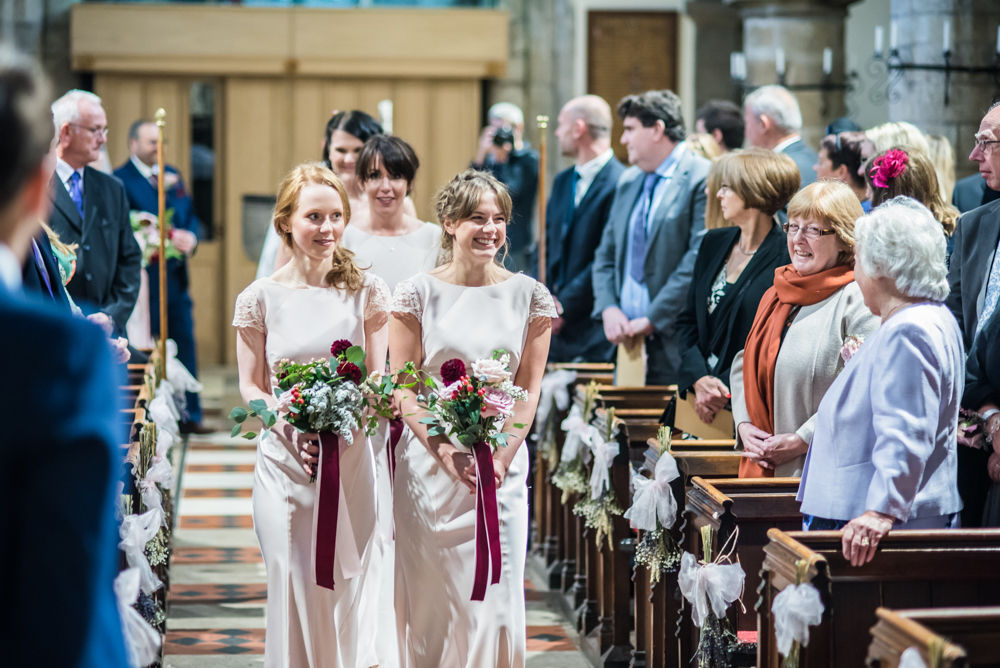 Bridesmaids walking down aisle, St James Church, Sheffield wedding photographers