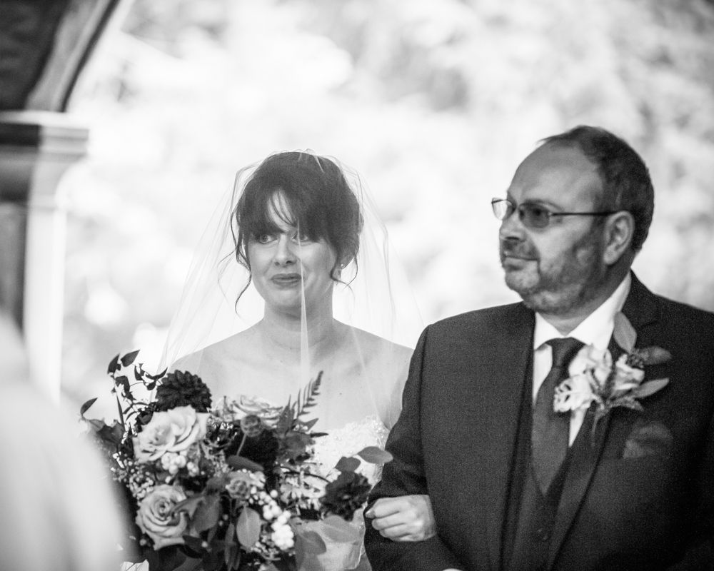 Dad and bride at church entrance, St James Church, Sheffield wedding photographers