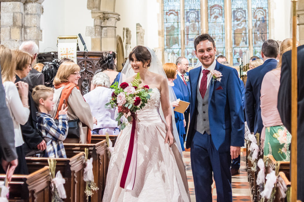 Walking down aisle, St James Church, Sheffield wedding photographers