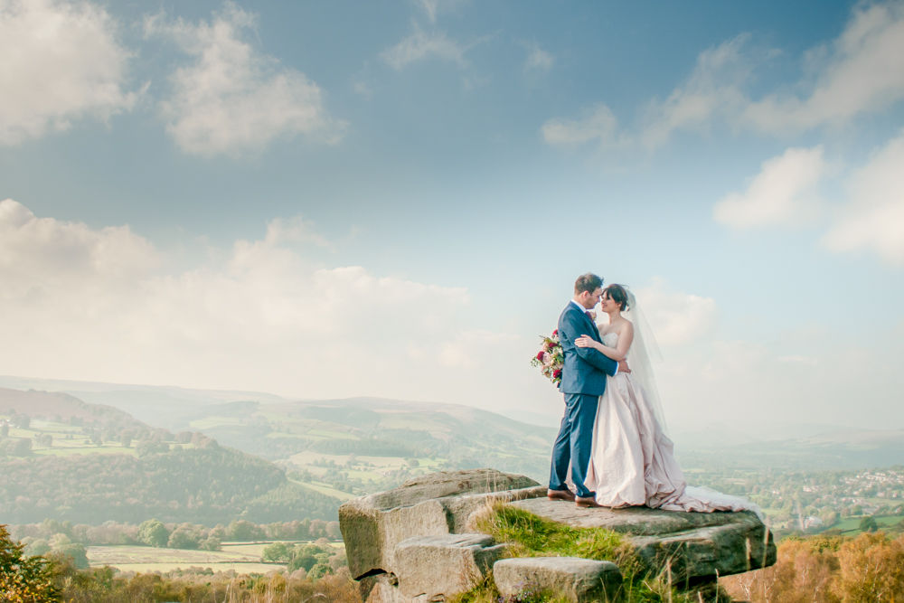 Bride and groom on rocks at Surprise View, Maynard Arms wedding, Sheffield photographers