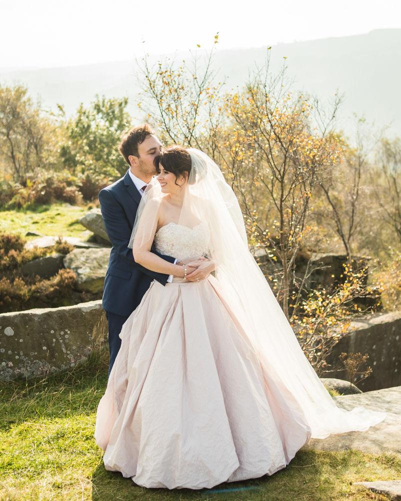 Groom kissing bride, Maynard Arms wedding, Sheffield photographers