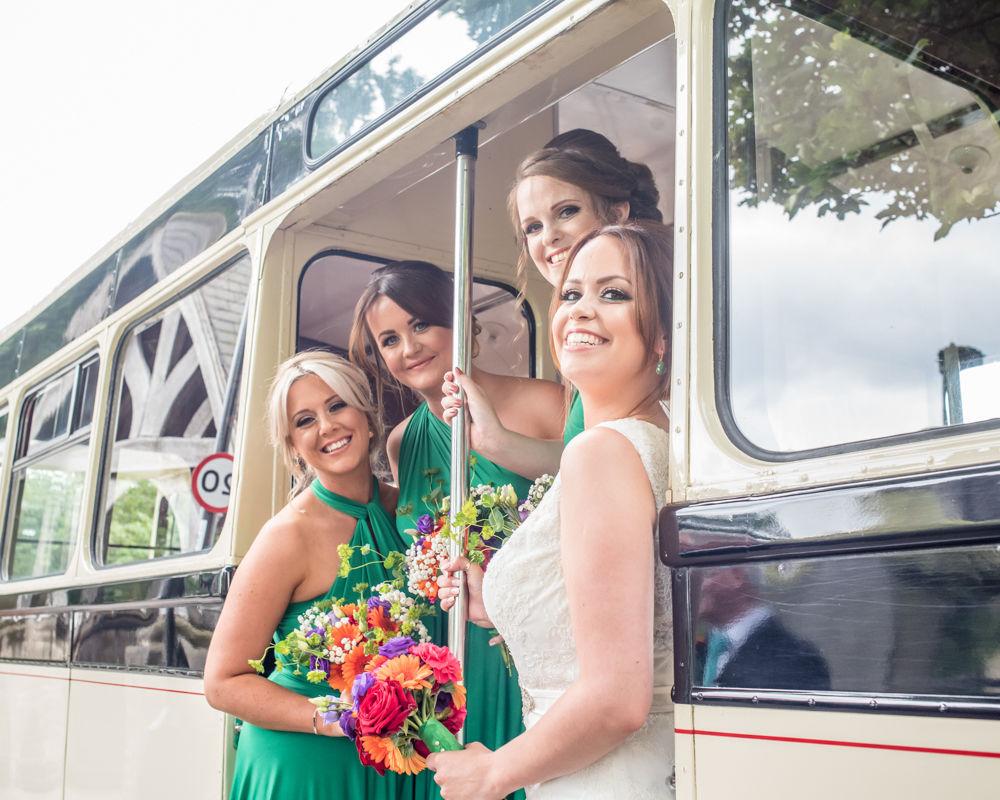 Sheffield wedding photographers, bride and bridesmaids on vintage bus