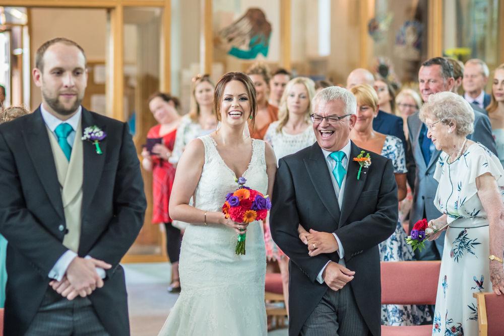 Bride and Dad walking up aisle, Sheffield wedding photographers, Christ Church Stannington
