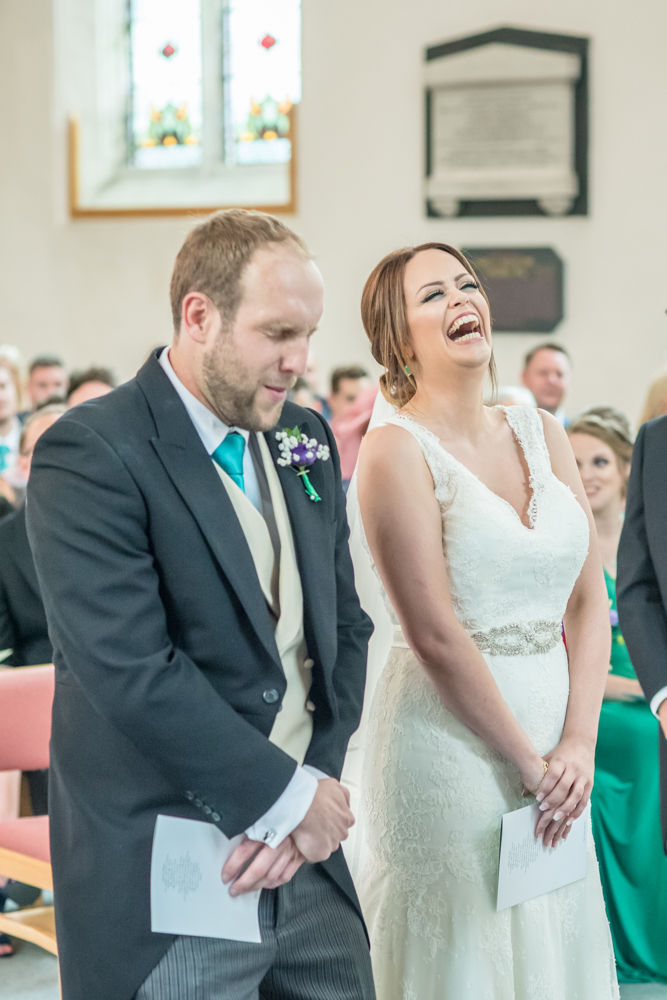 Bride laughing at ceremony, Sheffield wedding photographers,