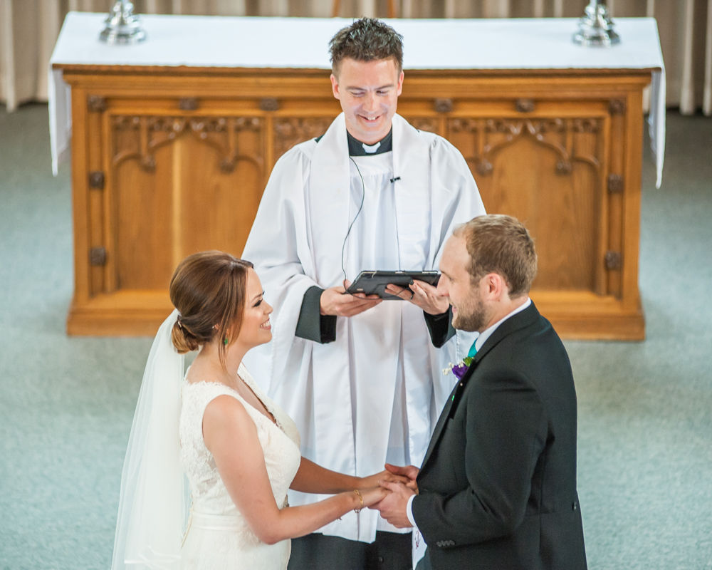 Exchanging vows, Christ Church Stannington, Sheffield wedding photographers,