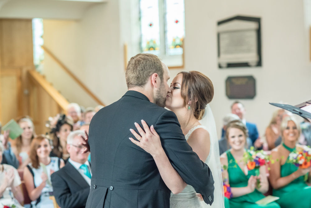Bride and Groom first kiss, Sheffield wedding photographers,